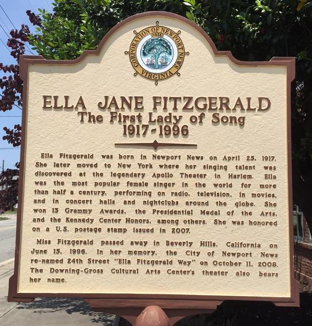 The image shows an historic marker in Newport News honors native and jazz legend Ella Fitzgerald.