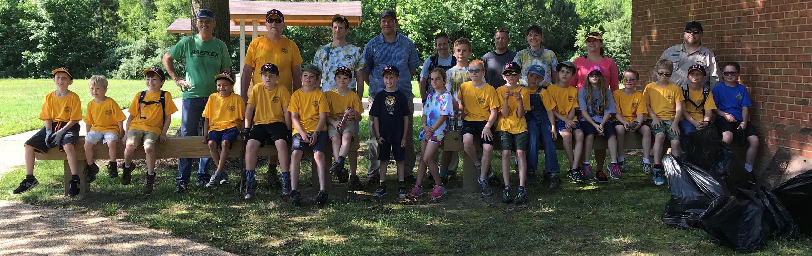 Boy Scouts participating in clean up efforts at Charles Brown Park